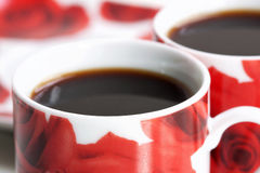 Close-up of two rose coffee cups Stock Photography
