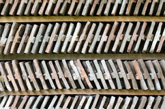 Close up on two rows of arranged bricks on a wood shelf. Stock Image