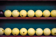 White billiard balls on shelf close. Close up two rows of white billiard balls for playing pool lying on shelves Royalty Free Stock Images