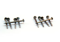 Close up of two sets of five nails on white Stock Photography