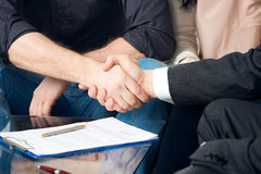 Close-up of two shaking hands Stock Images