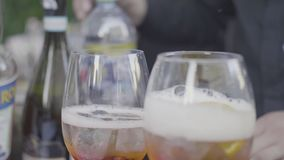 Close up for two shampagne glasses with ice cubes and bubbles on celebratory table. Frame. Glasses of sparkling stock video footage