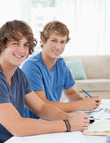 Close up of two smiling students looking into the camera Royalty Free Stock Photos