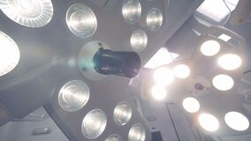 Close up of two surgical lamps hanging under the ceiling. 4K stock video