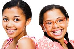 Close-up of two teenage girls. Smiling isolated over white Royalty Free Stock Photos