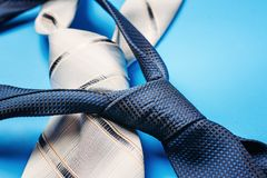 Close up two ties on blue background. Close up of two ties on blue background Royalty Free Stock Image