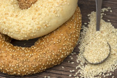 Close-up two types of bagel with sesame seeds in spoon Royalty Free Stock Images