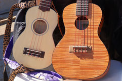 Close up of two ukuleles. Close up of two ukueles on chair Royalty Free Stock Photo