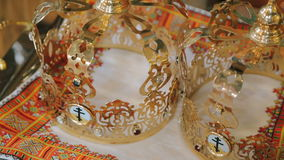 Close up of two wedding crowns prepared for ceremony of marriage in a church. In full HD stock video