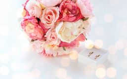 Close up of two wedding rings and flower bunch Stock Images