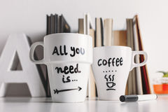 Close up of two white coffee mug with diy decoration. royalty free stock photo