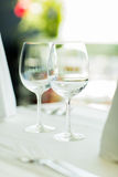 Close up of two wine glasses on restaurant table Royalty Free Stock Image