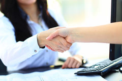 Close Up Of Two Women Shaking Hands Stock Photos