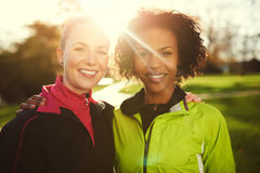 Close-up of two young sportswomen in park Stock Image