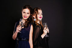 Close-up  two young women with glasses of wine Royalty Free Stock Photos
