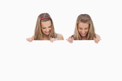 Close-up of two young women holding a blank board Stock Photo