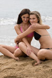 Close-up of two young women smiling on the beach Royalty Free Stock Images