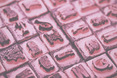 Close up of type set rubber stamps Vintage Retro Filter. Royalty Free Stock Photography