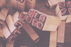 Close up of type set rubber stamps Vintage Retro Filter. royalty free stock photo