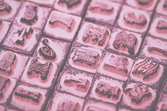 Close up of type set rubber stamps Vintage Retro Filter. Royalty Free Stock Image