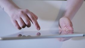 In this close up type of shot you can see young woman holding touch screen tablet device in her hands stock footage