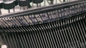 Close up on the types of an old typewriter. rotate stock footage