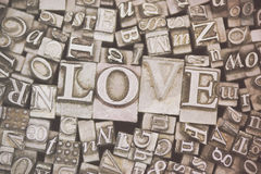 Close up of typeset letters with the word Love Stock Photo