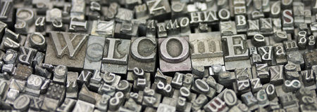 Close up of typeset letters with the word Welcome Royalty Free Stock Images