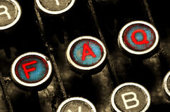 Close up on typewriter faq keys Royalty Free Stock Images