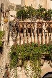Typical Balcony - Taormina Town Sicily Italy. Close-up of a typical balcony in wrought iron in the Taormina town, Sicily island, Messina, Italy, Europe Stock Image
