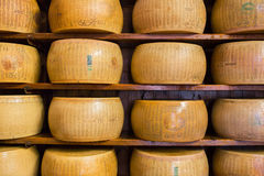 Close up of typical Italian hard Parmesan cheese on the shelves Stock Photography