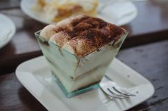 Close up of typical Italian sweet pastry - Tiramisu with mascarpone in transparent cup stock images