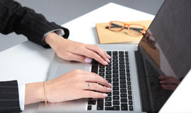 Close-up of typing female hands on keyboard Royalty Free Stock Photo