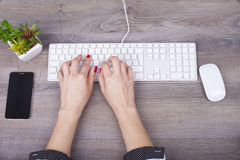 Close-up of typing female hands on keyboard Royalty Free Stock Image