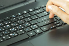 Close-up of typing female hands on keyboard. Enter selective focus Royalty Free Stock Photos