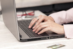Close-up of typing female hands on keyboard, she surfs the inter Royalty Free Stock Image