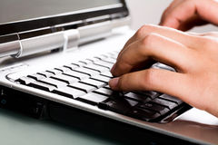 Close-up of typing hands Stock Images