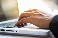 Close-up of typing male hands Stock Photography