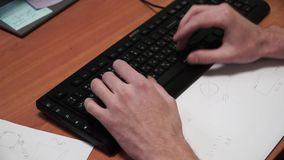 Close-up of typing male hands. Clip. Hands on keyboard. Close-up of male hand before touching button of black computer stock footage
