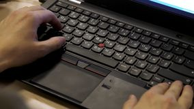 Close-up of typing male hands. close up blurred view of male hand touching computer keyboard. Close-up of male hands royalty free stock photo