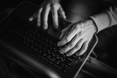 Close-up typing male hands on laptop keyboard Stock Photo