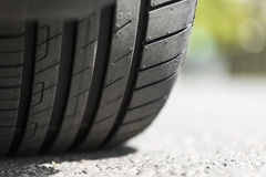 Close up of a tyre tread on a road Royalty Free Stock Image