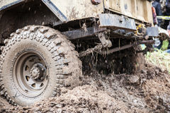 Close up of Uaz 469 overcomes a muddy pit. Royalty Free Stock Photo