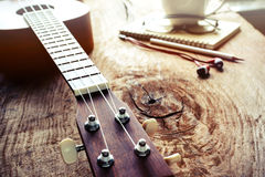 Close up of ukulele on old wood background with soft light Stock Images