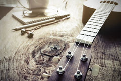 Close up of ukulele on old wood background with soft light Stock Images