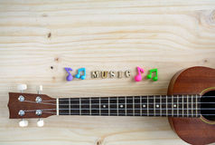 Close up of ukulele on old wooden background Royalty Free Stock Image