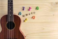 Close up of ukulele on old wooden background Royalty Free Stock Image