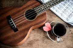 Close up of ukulele on old wooden background Stock Images