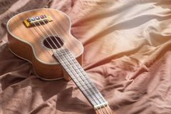 Close up ukuleles. On cotton background., copy space Royalty Free Stock Photos