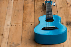 Close up ukuleles on wooden background. Close up blue ukuleles on wooden background Stock Image